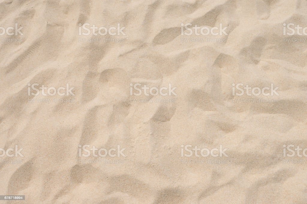 closeup of sand pattern of a beach in the summer stock photo