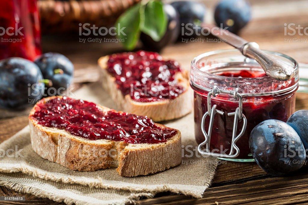 Closeup of sandwich with fresh plum jam stock photo