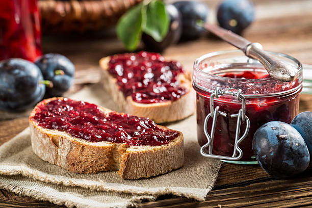 Closeup of sandwich with fresh plum jam stock photo