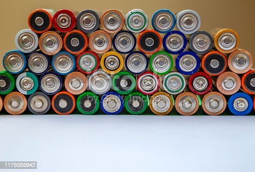 istock Closeup of saws of used alkaline batteries. Several in rows. Ecological pollution. 1175055942