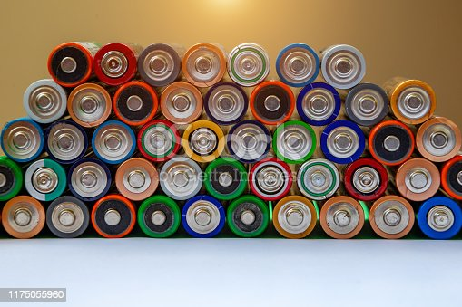 istock Closeup of saws of used alkaline batteries. Several in rows. Ecological pollution. 1175055960