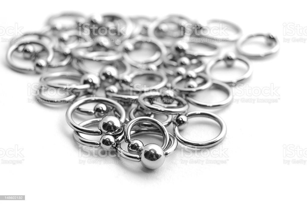 Close-up of scattered stainless circulars with beads stock photo