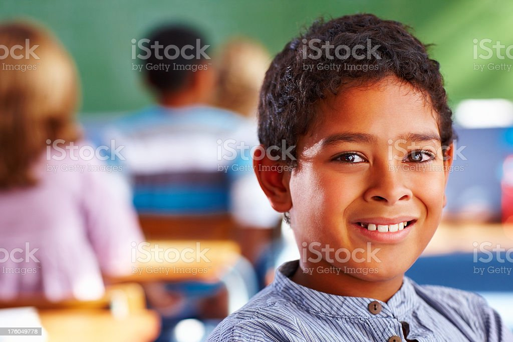 Close-up of schoolboy smiling royalty-free stock photo