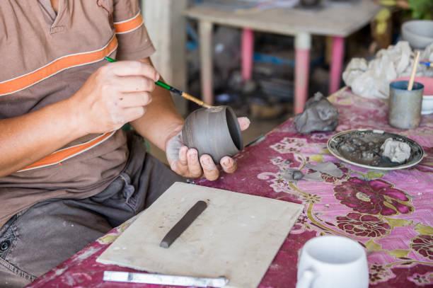 Closeup of sculptor man hand with him job stock photo