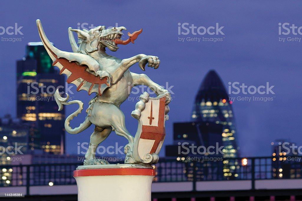 Close-up of sculpture of City of London Dragon at night stock photo