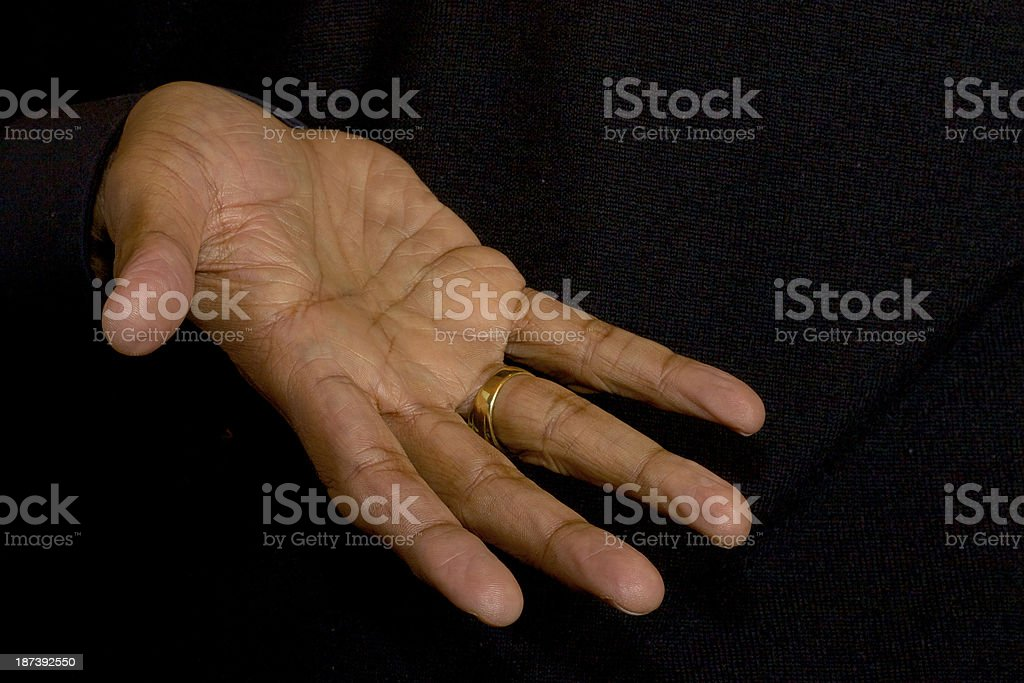 Open right hand of older asian male royalty-free stock photo