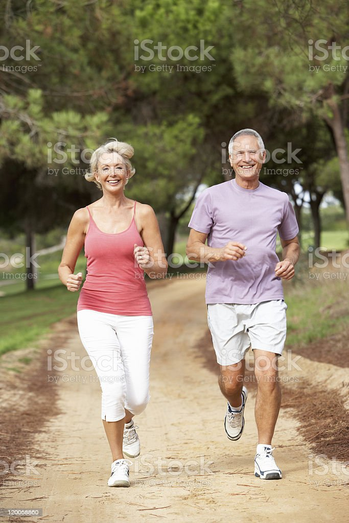 Close-up of senior couple jogging in the park royalty-free stock photo