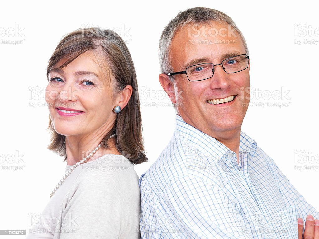 Close-up of senior couple smiling against white background royalty-free stock photo