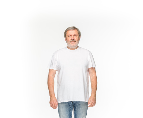 istock Closeup of senior man's body in empty white t-shirt isolated on white background. Mock up for disign concept 961779808