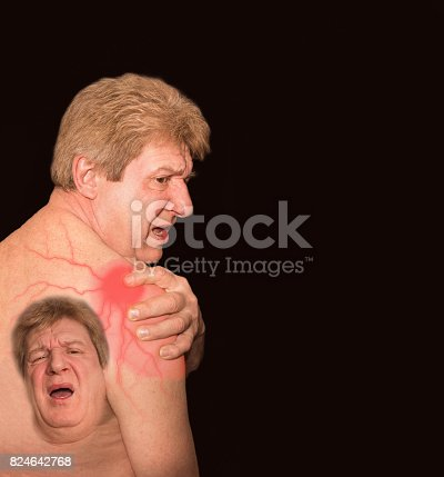 istock Close-up of senior shirtless man with shoulder pain over black background 824642768