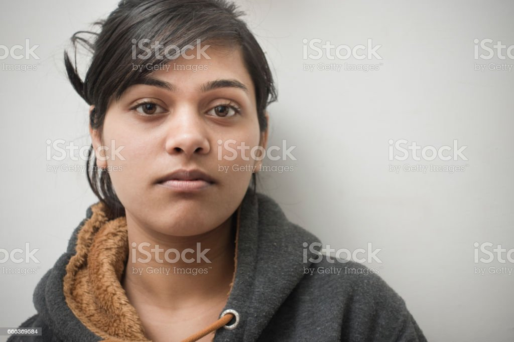 Close-up of serene Asian girl thinking. stock photo