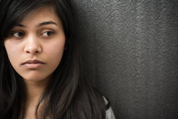 Close-up of serene Asian girl thinking. stock photo