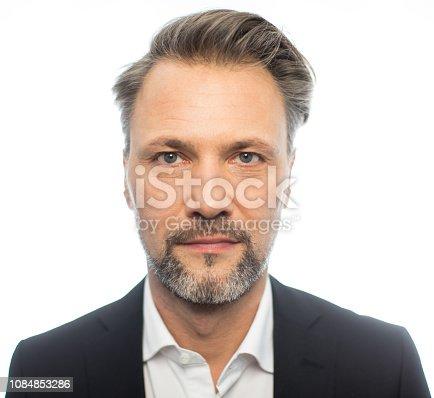805011368 istock photo Close-up of serious mature businessman 1084853286
