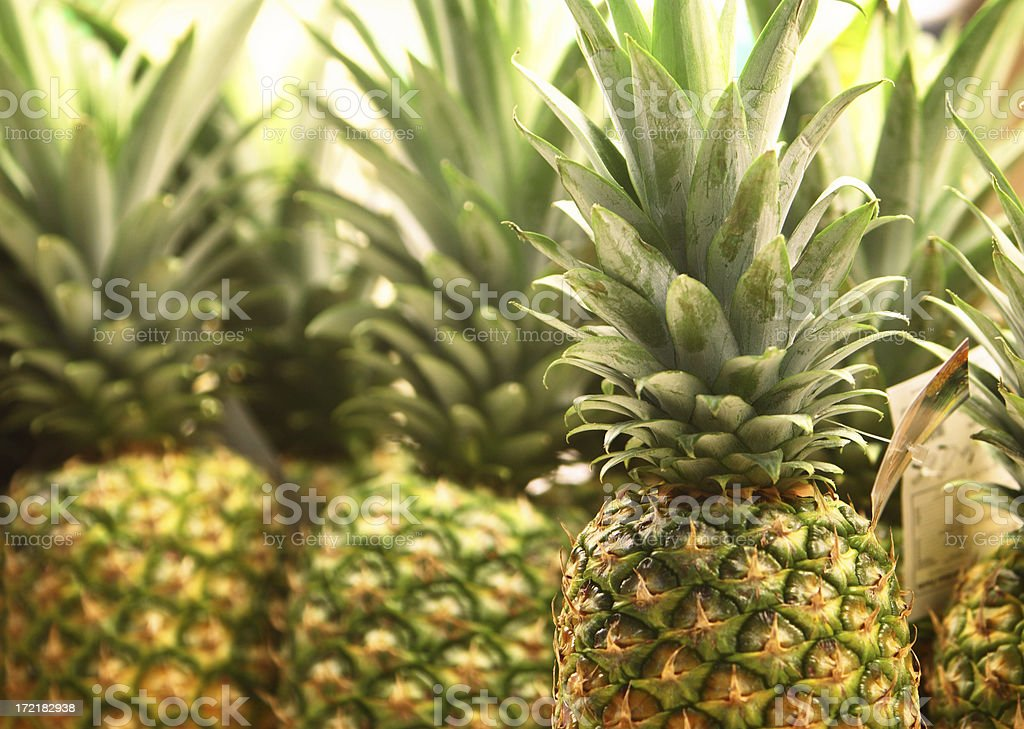 Close-up of several fresh pineapples royalty-free stock photo