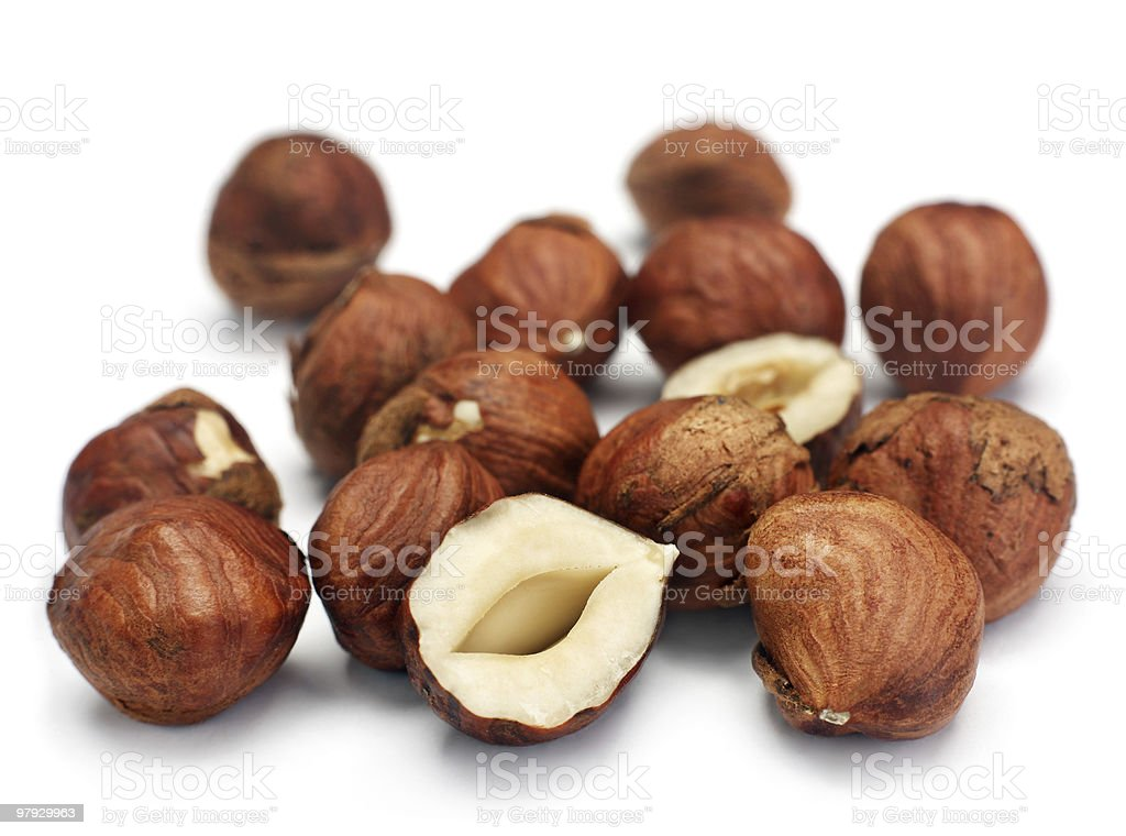 Close-up of several hazelnuts laying on a white background royalty-free stock photo