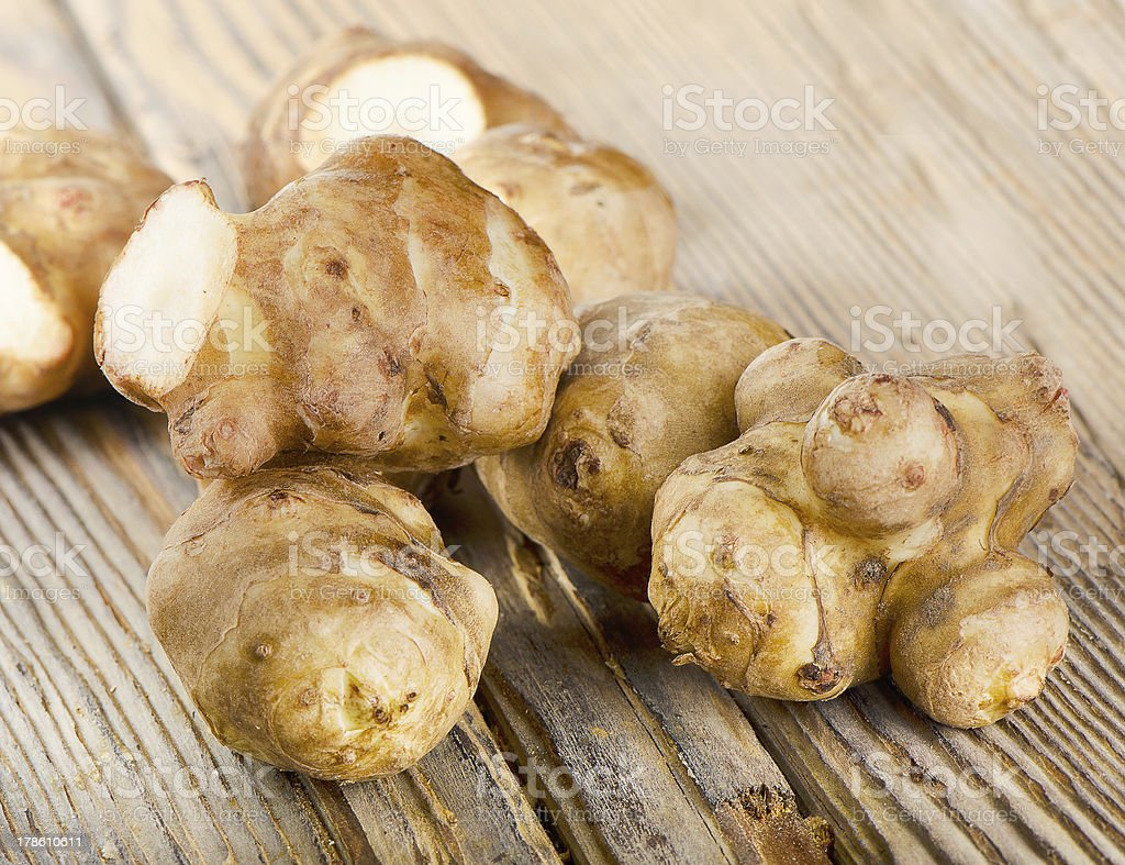 Close-up of several pieces of Jerusalem artichokes on table stock photo