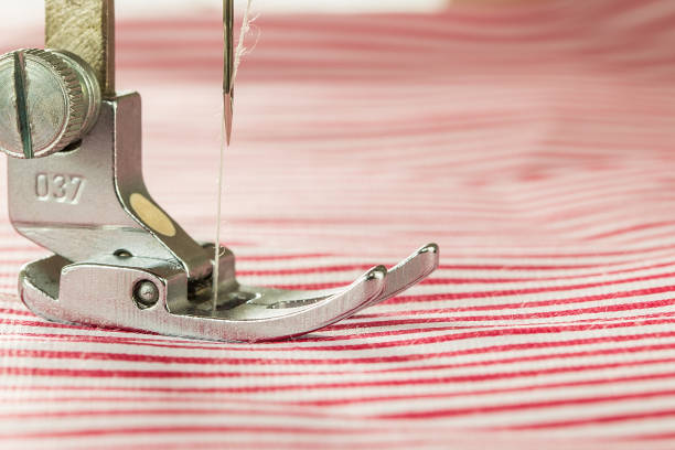 close-up of sewing machine and fabric - sewing machine needle stock photos and pictures