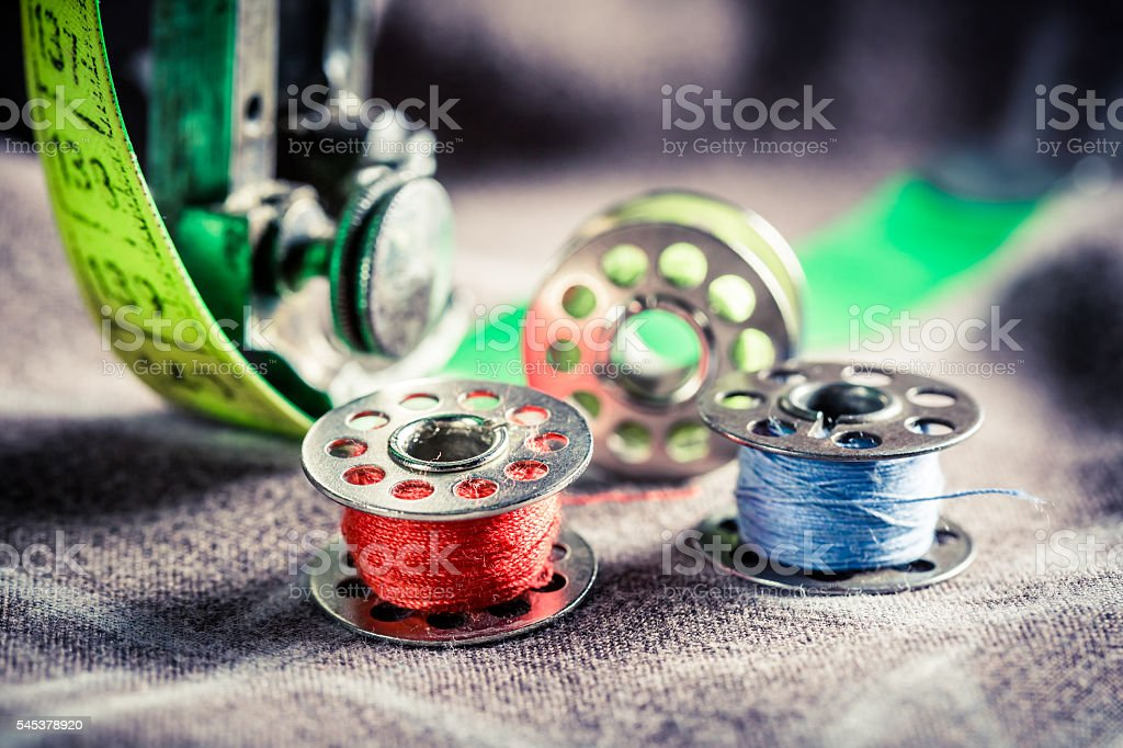 Closeup of sewing machine with colored threads and tailor tape – Foto