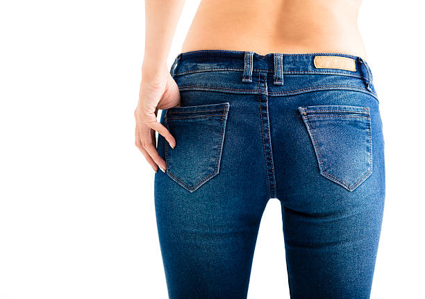 closeup of sexy woman wearing jeans - buttock stock photos and pictures