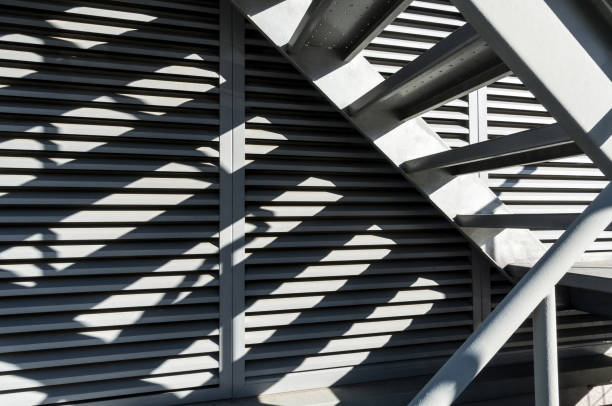Close-up of shady iron stairs stock photo