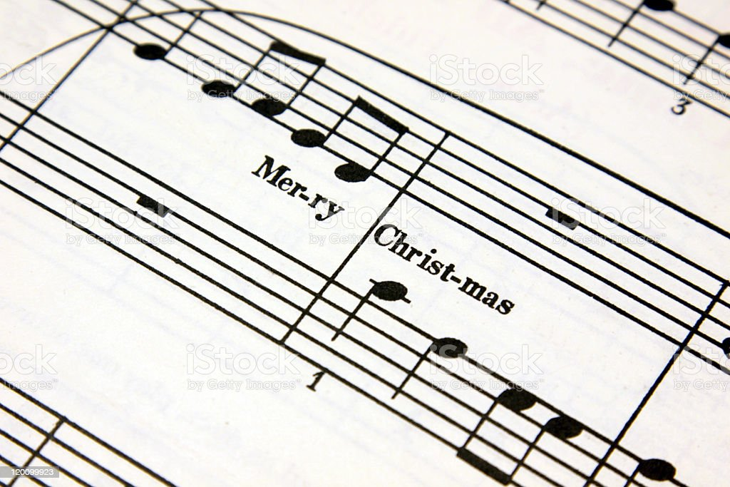 Close-up of sheet music with lyrics for a Christmas song stock photo