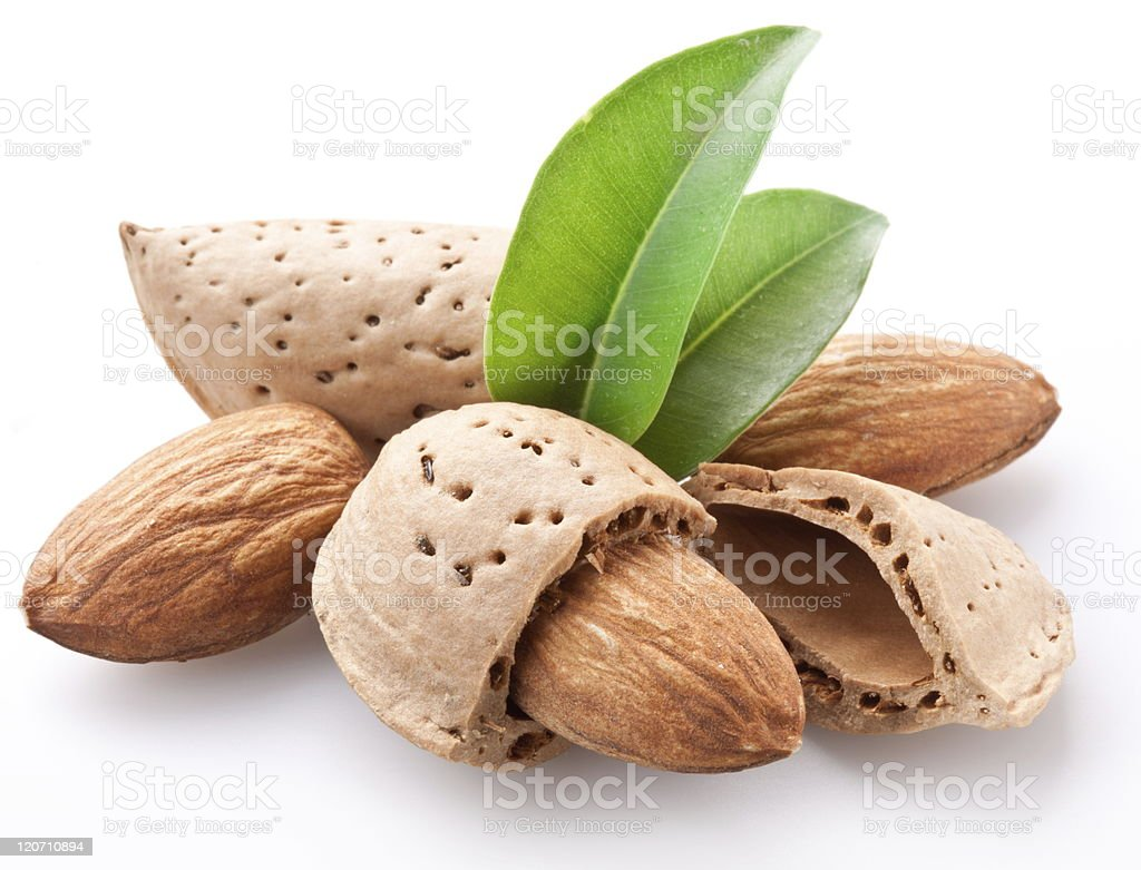 Close-up of shelled and unshelled almonds stock photo