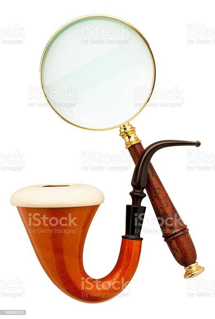 Close-up of Sherlock Holmes pipe and magnifier stock photo