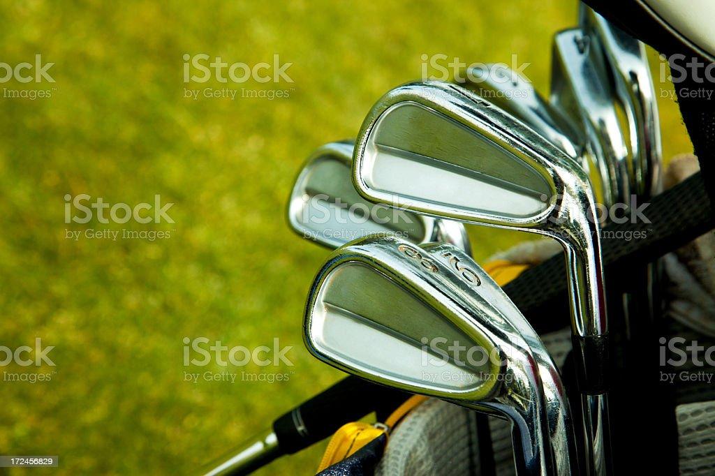 Close-up of shiny chrome golf clubs stock photo