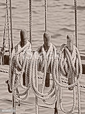 501889762istockphoto close-up of ship's rope an an old wooden sailing ship in monochrome 820858720