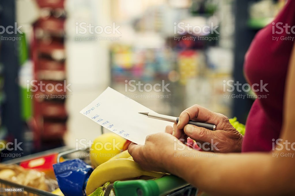 Close-up of shopping list stock photo