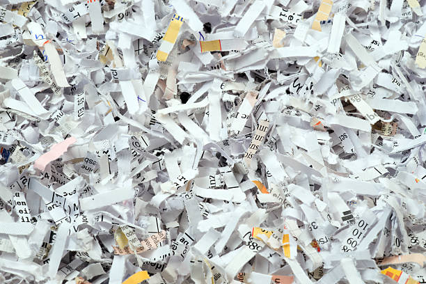 closeup of shredded paper documents - shredded paper stock photos and pictures
