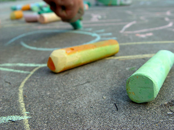 Close-up of sidewalk chalk on concrete stock photo