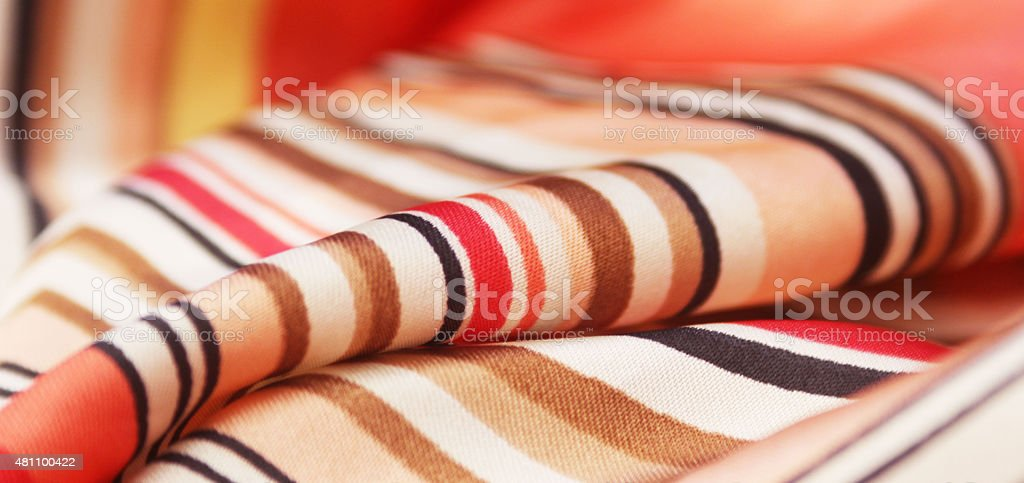 Closeup of Silk Scarf Wave of Colours in Warm Colours stock photo