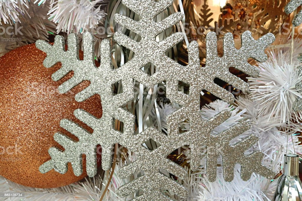 Closeup Of Silver Glitter Snowflake Shaped Christmas Ornament With Gold Gritter Ball Shaped Ornament In Background Stock Photo Download Image Now Istock
