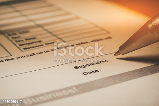 94113879 istock photo Close-up of silver pen are signing the contract policy agreement papers. Legal contract signing. 1160969417