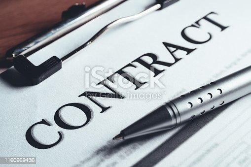 94113879istockphoto Close-up of silver pen put on the contract policy agreement papers. Legal contract signing. 1160969436