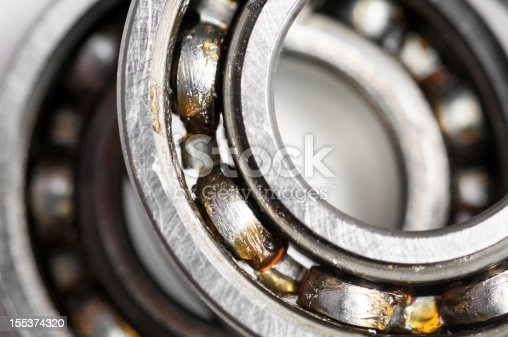 Closeup of a pair of bearing used in motor for home appliances. Top view on a white background.