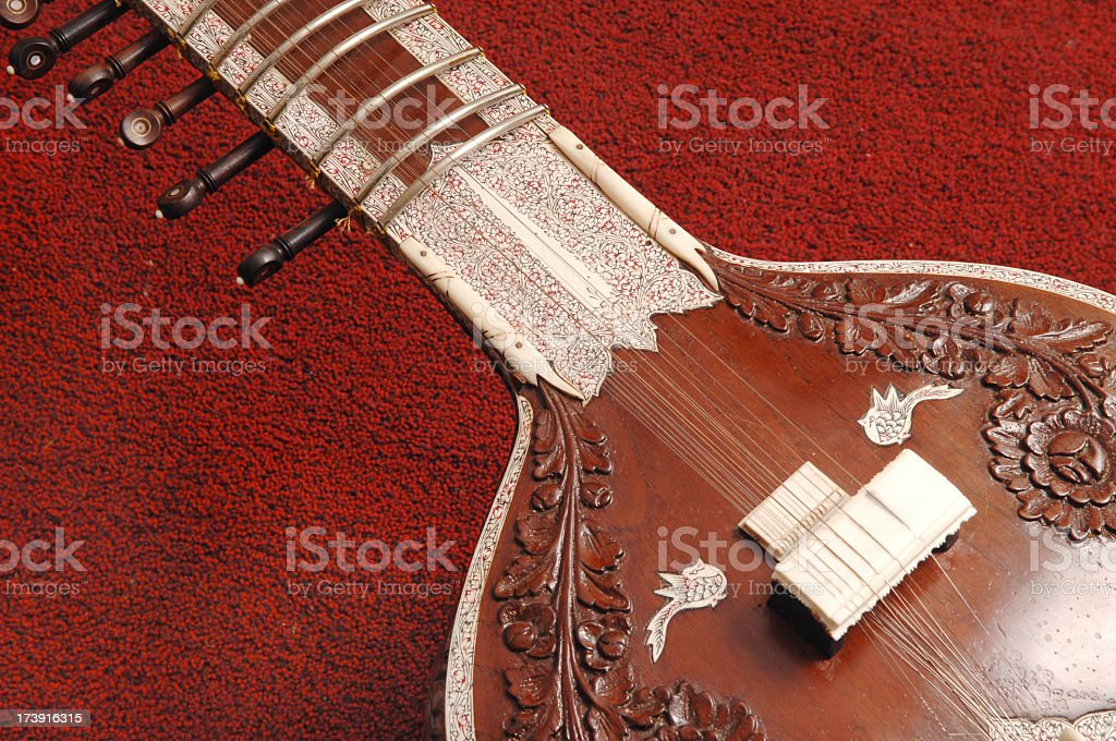 Close-up of sitar on red carpet stock photo