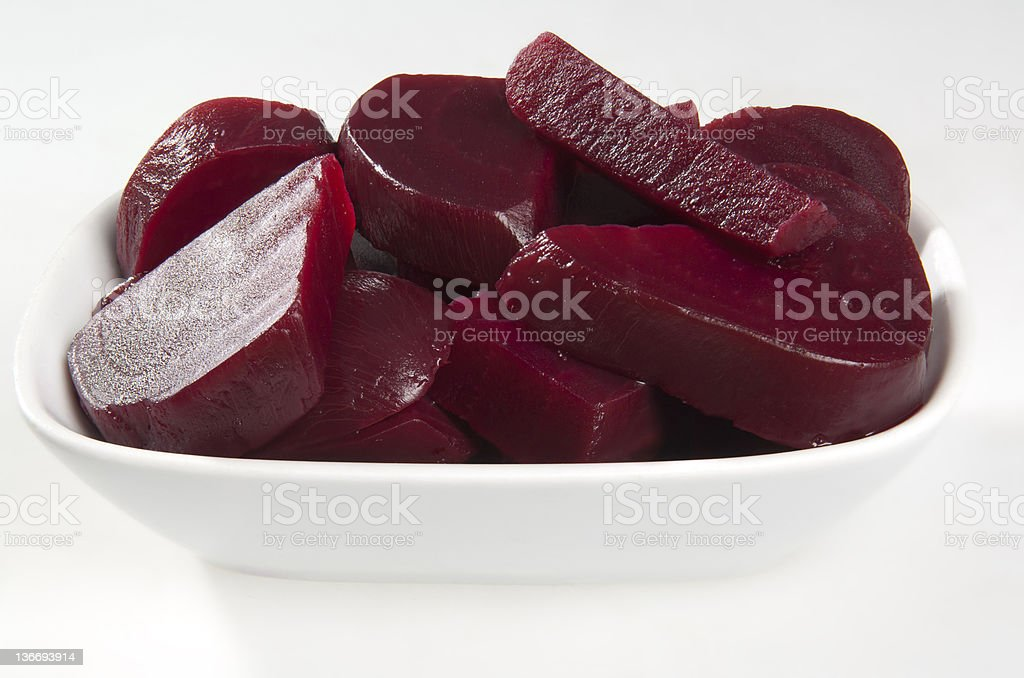 Close-up of sliced canned beets in white serving bowl royalty-free stock photo