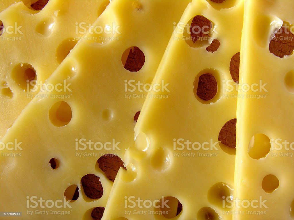 Close-up of slices of Swiss cheese royalty-free stock photo