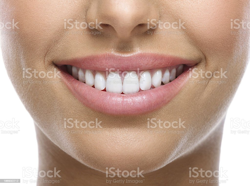 closeup of smile with white teeth stock photo