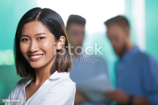 1003539592istockphoto Closeup of Smiling Attractive Young Asian Woman 626840548
