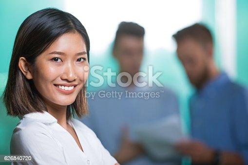 1003539592istockphoto Closeup of Smiling Beautiful Young Asian Woman 626840720