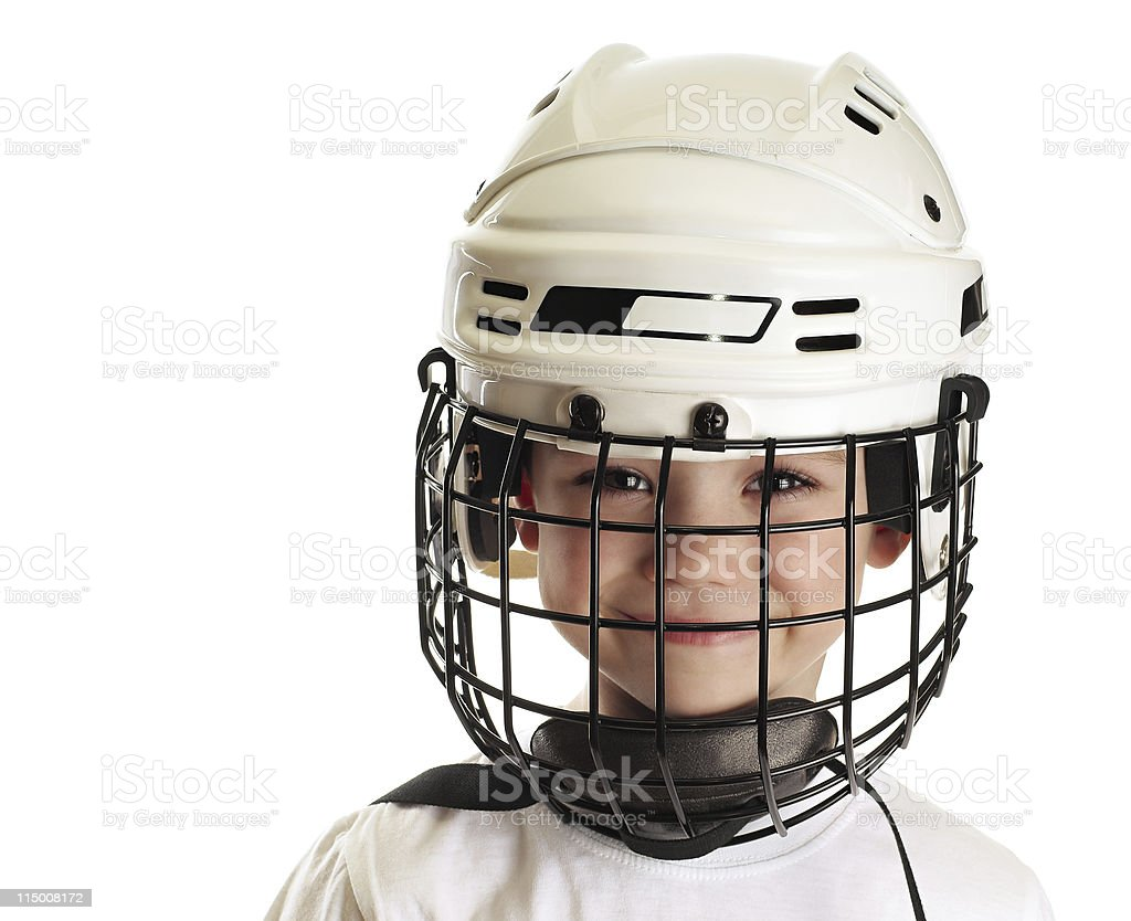 Close-up of smiling boy wearing white hockey helmet stock photo