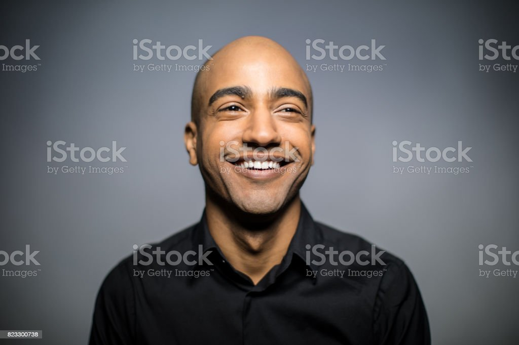 Close-Up Of Smiling Mid Adult Man Looking Away stock photo
