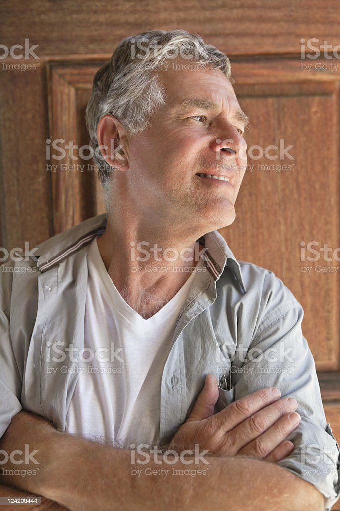Close-up of smiling senior man standing at the door royalty-free stock photo