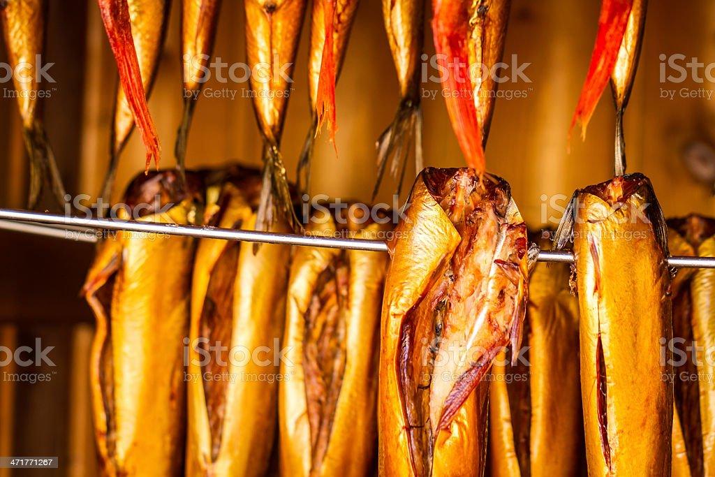 Closeup of smoked fish in smokehouse royalty-free stock photo