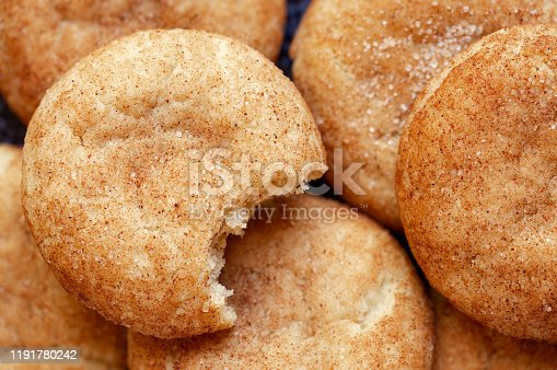 Overhead view of homemade snickerdoodle cookies with a bite missing