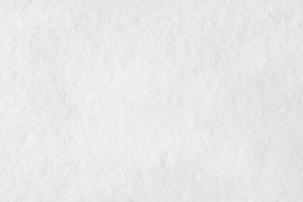 Closeup of snow for winter or Christmas background stock photo
