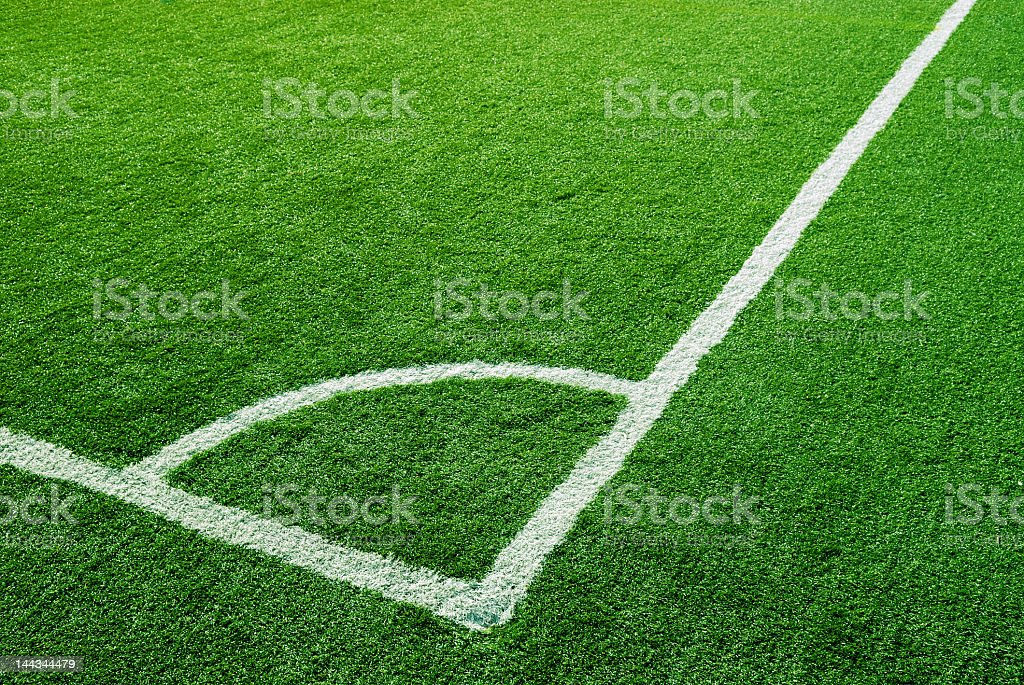 Close-up of soccer field corner white lines royalty-free stock photo